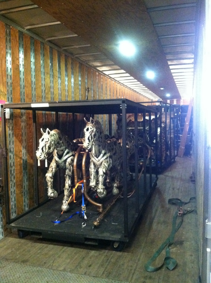 The horses arrive in one of the trucks on day two of load-in.