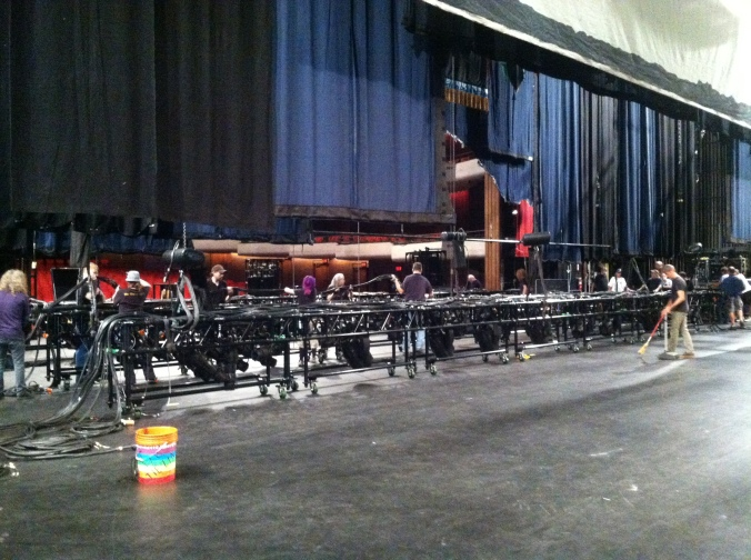 Preparing the stage lights on day one of load-in for Cinderella.