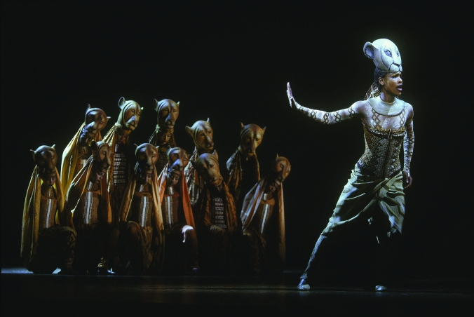 Kissy Simmons, as Nala, and the Lionesses in The Lion King.