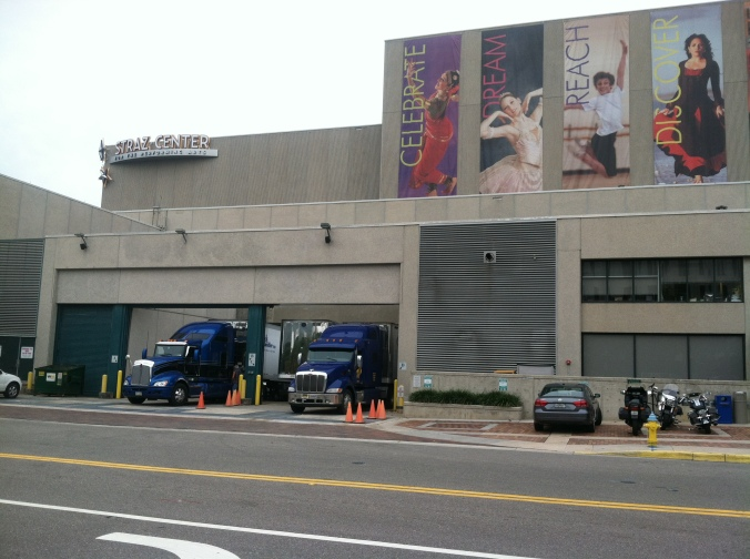 More trucks arrive for day two of load-in for Cinderella.
