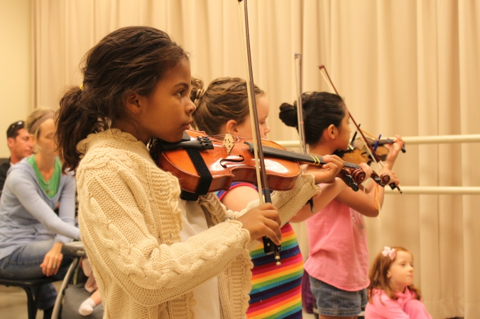 Students in a Suzuki Violin class at the Straz Center's Patel Conservatory.